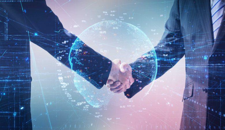 comércio internacional - duas pessoas de terno dão aperto de mão